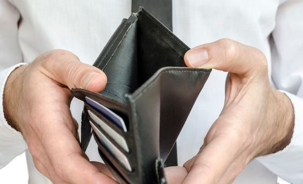Man holding an empty wallet